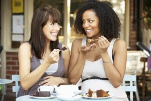 Two women enjoying desert at Pulse Cafe in Hadley MA.
