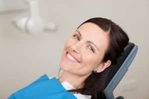 Woman smiling after restorative dentistry treatment at River Valley Dental in Hadley MA.