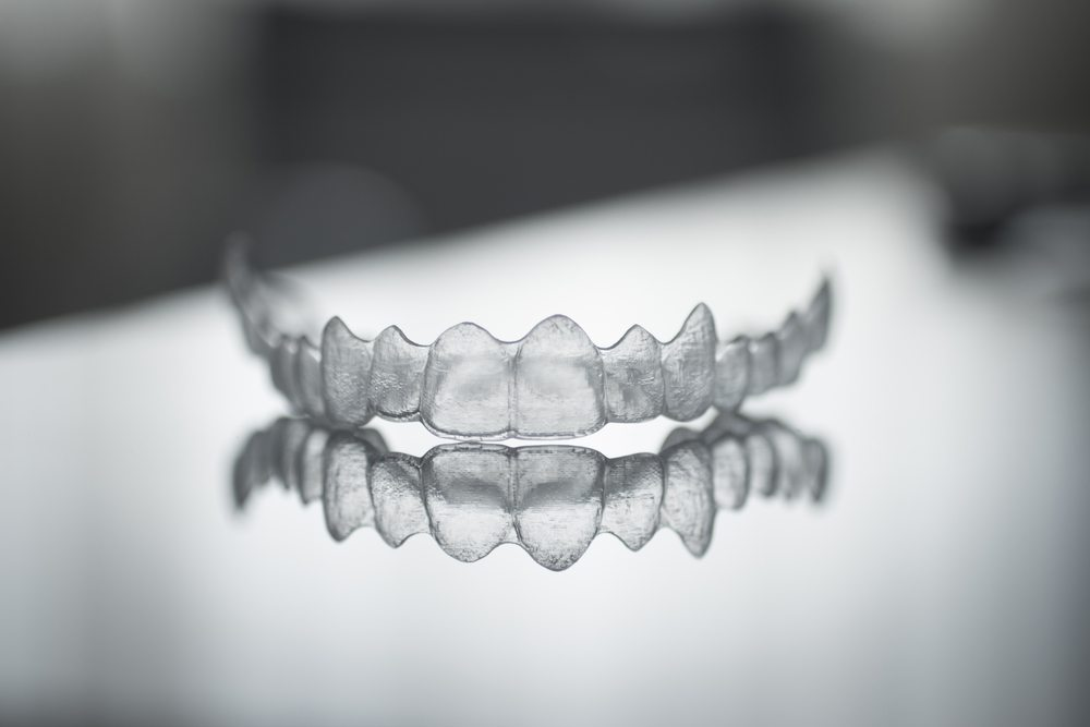 Image of invisalign clear braces whitening tray.