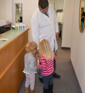 Dr. Gojgini talks with some of his younger patients who come in for pediatric dentistry services at River Valley Dental in Hadley MA.