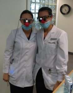 Members of Dr. Gojgini's team wear read noses to help relieve anxiety with their pediatric patients at River Valley Dental in Hadley MA.