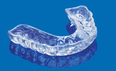 Image of a night guard used to prevent sleep apnea symptoms from affecting your health.